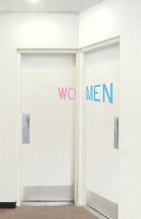 two washroom doors adjacent to each other. One reads wo, the other  reads men